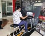 Edukasi Keselamatan Berkendara dengan alat Simulator Honda Riding Trainer